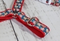 Dog harness with flowers in beige on turquoise, webbing in red, width 30mm