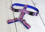 Dog harness with pattern in blue, pink, yellow and red, webbing in blue, width 30mm